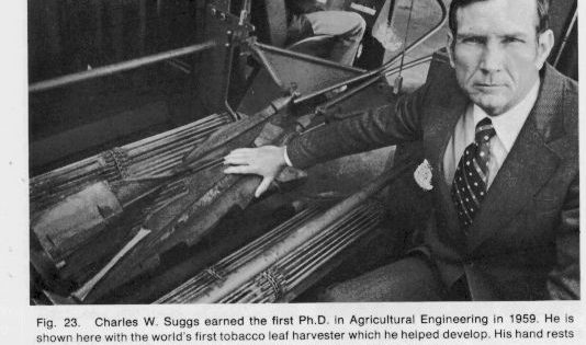 Photo Charles Suggs PhD in Ag engr. 1959 pictured with the worlds first tobacco leaf harvester which he developed.